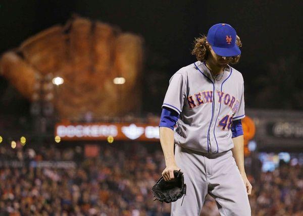 New York Mets starting pitcher Jacob deGrom walks