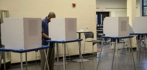Emmet Bowen votes at the polling place at