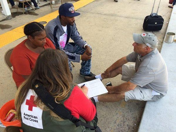 Craig Cooper, right, an American Red Cross volunteer