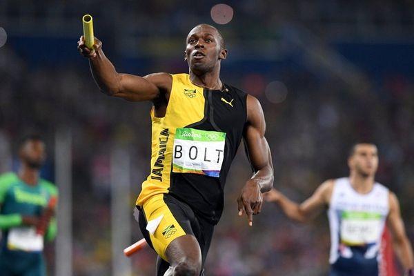 Usain Bolt of Jamaica crosses the finish line