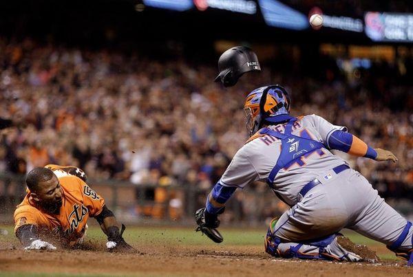 San Francisco Giants' Eduardo Nunez, left, slides to