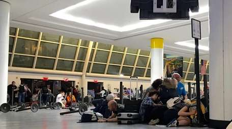 Air travelers crouch and lie flat on Sunday,