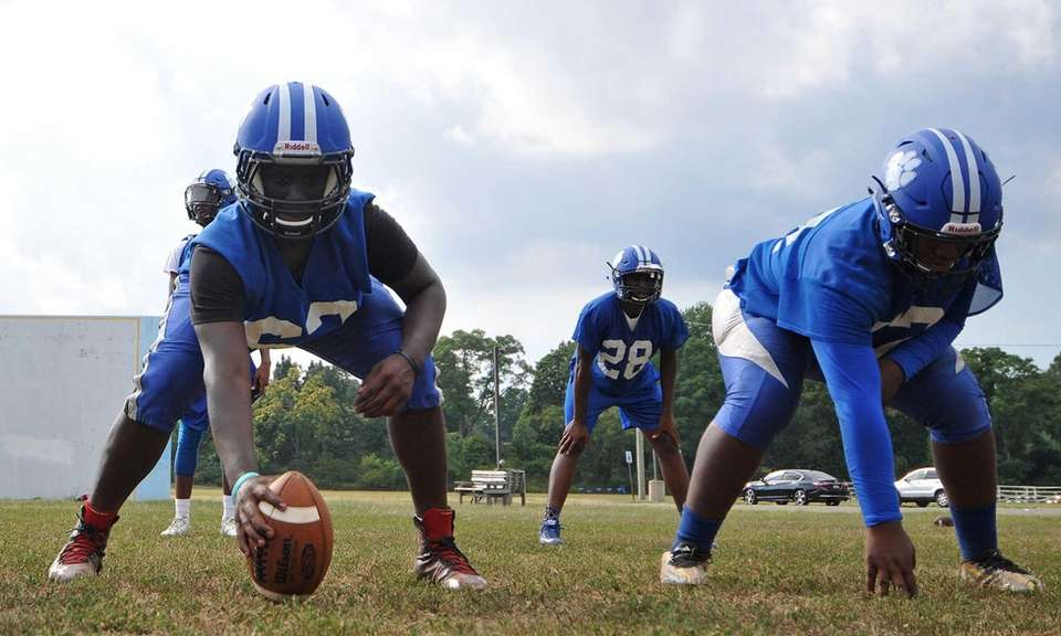 Andre Heslop #62, Hempstead center, gets ready to
