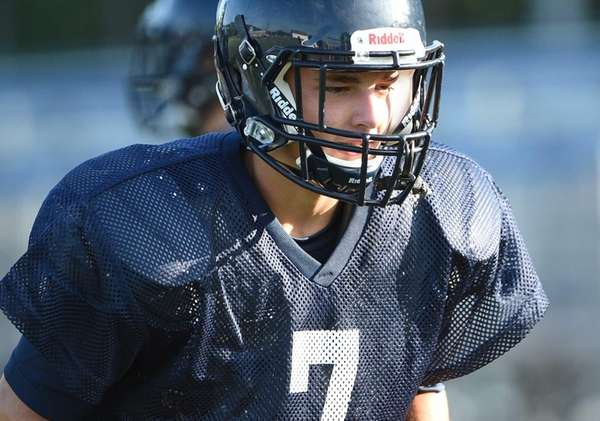 Smithtown West running back/linebacker James Caddigan runs through