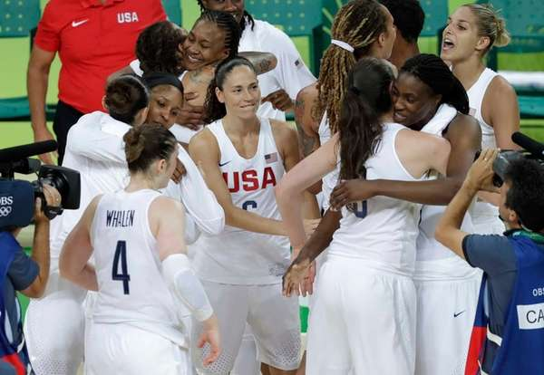 United States players celebrate after the gold medal
