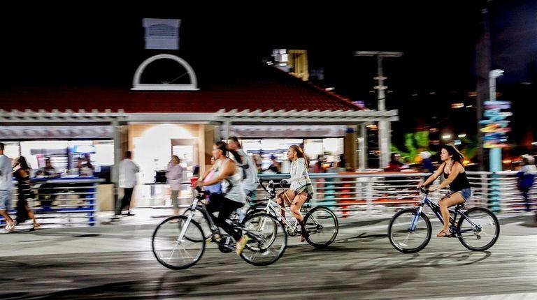 Bikers on the Long Beach boardwalk in Long