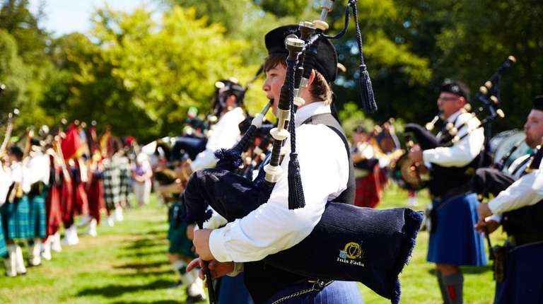 The Inis Fada Gaelic Bagpipers march at the