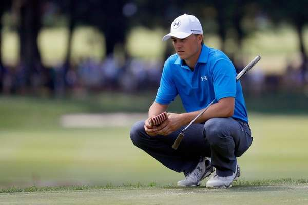 Jordan Spieth of the United States lines up