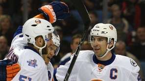 New York Islanders' Frans Nielsen (51) and Kyle