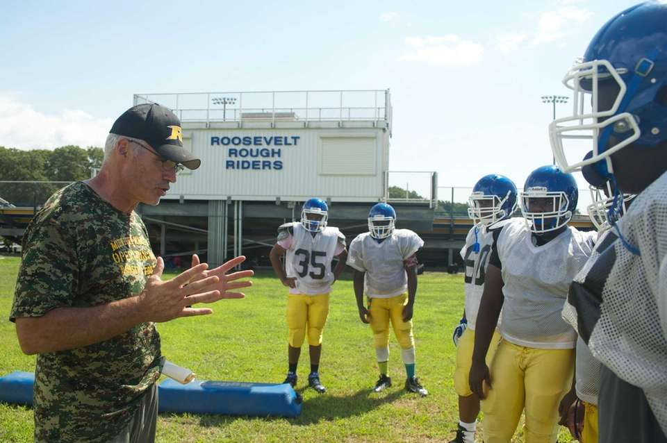 Coach Tom McNally gives instructions during practice at