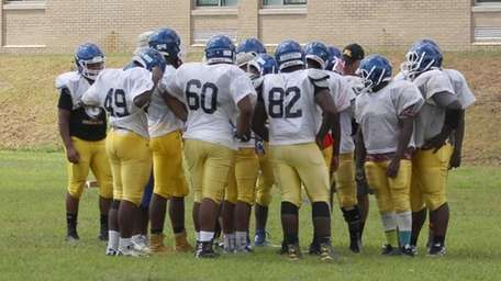 Players get instructions during practice at Roosevelt High