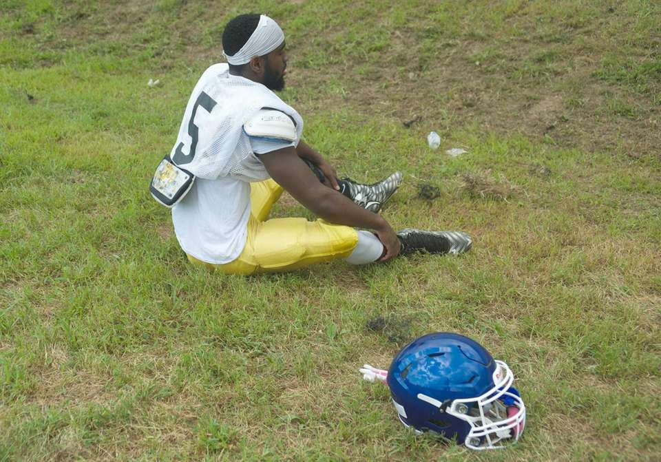 Corey Bull takes a break during practice at