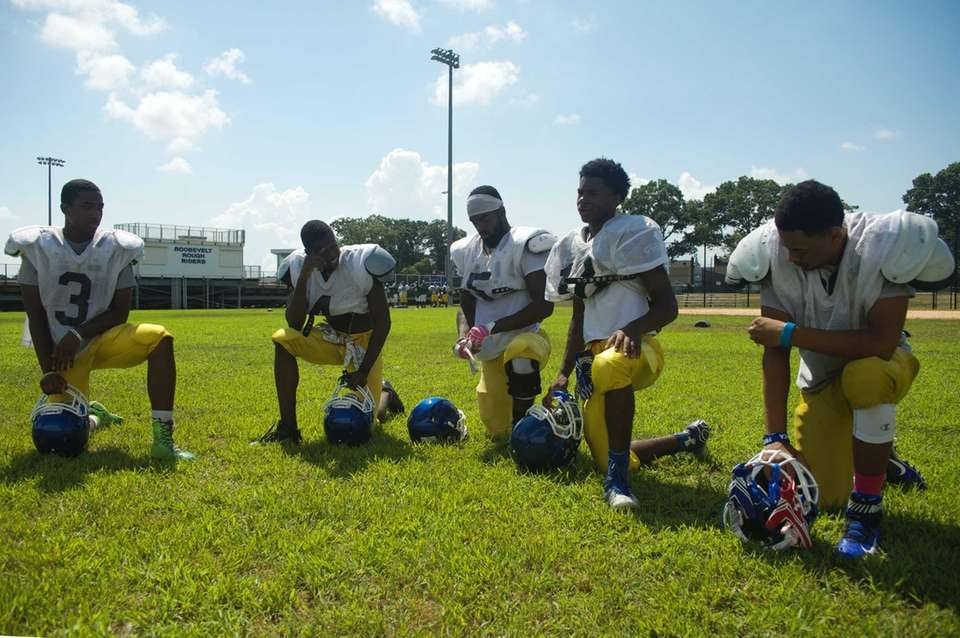 Players take a break during practice at Roosevelt