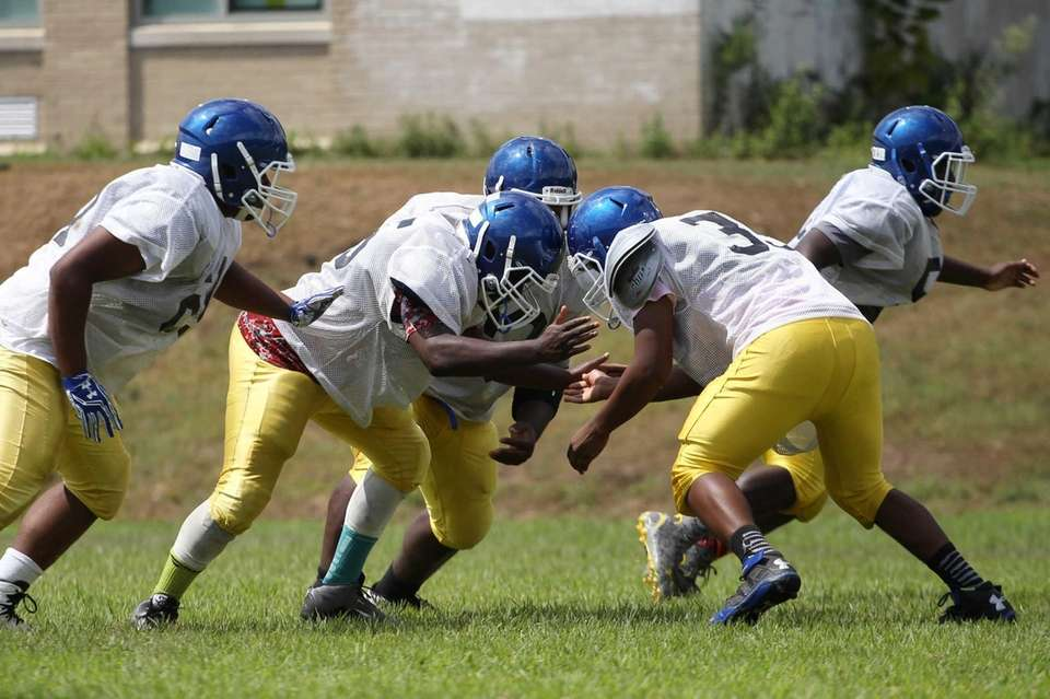 Players make a block during practice at Roosevelt
