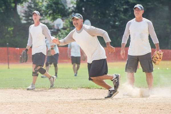 Former Mets relief pitcher John Franco runs from