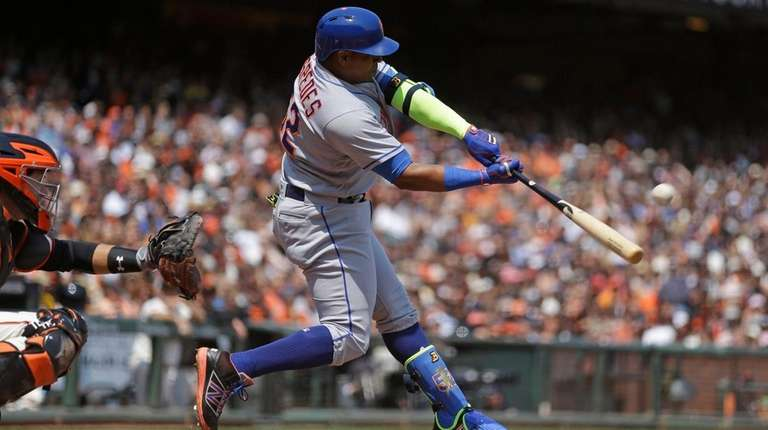 Yoenis Cespedes hits the first of his