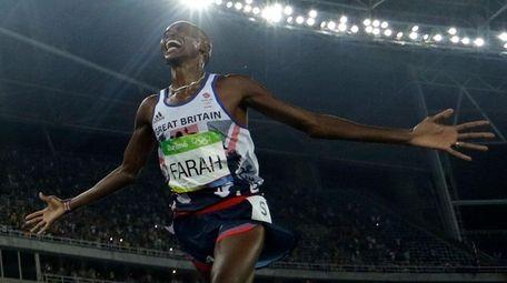Britain's Mo Farah crosses the line to win