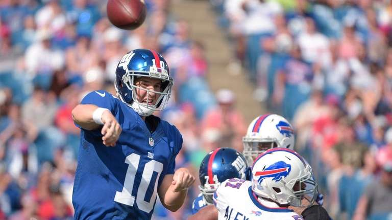 New York Giants quarterback Eli Manning passes against