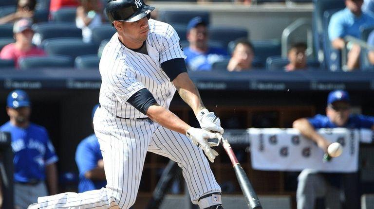 New York Yankees designated hitter Gary Sanchez singles