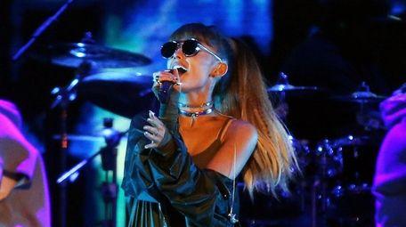 Ariana Grande sings onstage for the 2016 Billboard