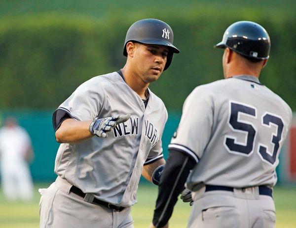 New York Yankees' Gary Sanchez, left, is congratulated