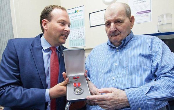 Korean War veteran Warren Wilkins, 86, receives a