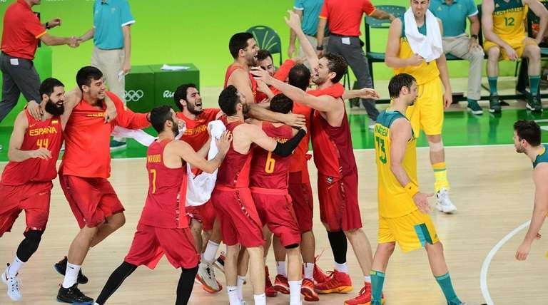 Spain power forward Nikola Miroticm, left, center Pau