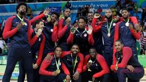 The United States' team pose with their gold