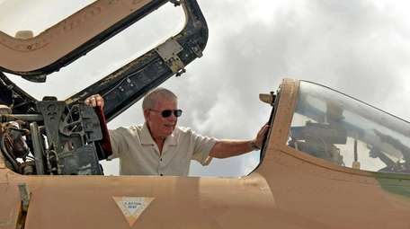 Retired Air Force Colonel Fred Claussen looks into