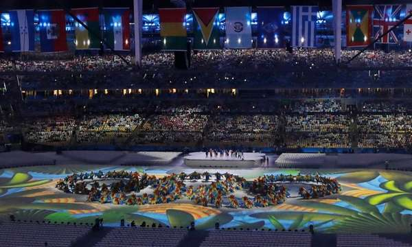 Dancers form the Olympic rings during the closing