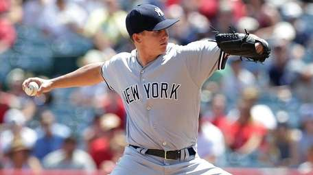 New York Yankees starting pitcher Chad Green delivers