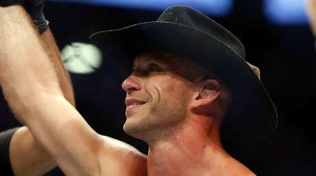Donald Cerrone raises his hand after defeating Rick