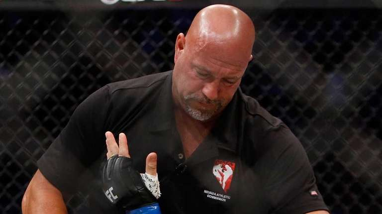 Referee Dan Miragliotta checks on Glover Teixeira after