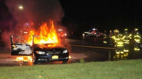 The Huntington Manor Fire Department extinguishes a BMW