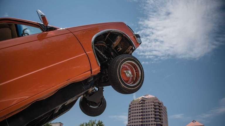 A couple of dozen lowrider cars appeared at