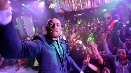 Conor McGregor celebrates his UFC 202 victory during