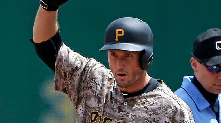 Pittsburgh Pirates' David Freese celebrates as he stands