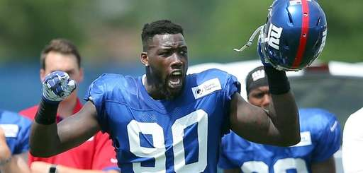 Giants defensive end Jason Pierre-Paul reacts as the