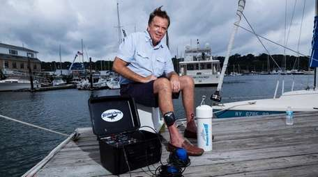 SharkStopper founder Brian Wynne with his shark-repellent devices