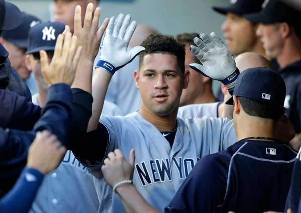 New York Yankees Gary Sanchez is greeted in