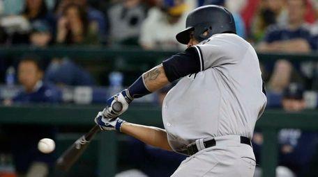 The New York Yankees' Gary Sanchez hits a