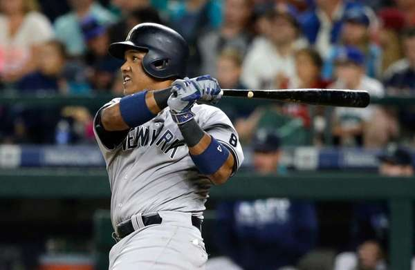 The New York Yankees' Starlin Castro watches his