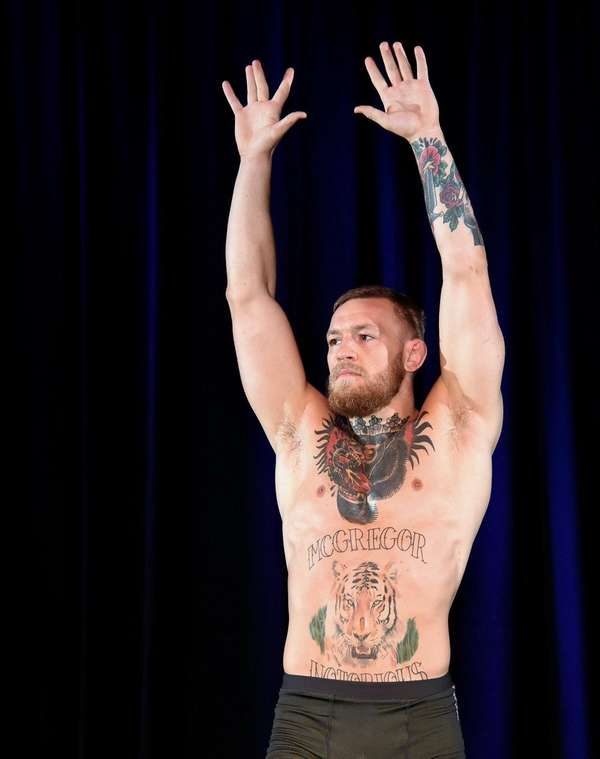 UFC featherweight champion Conor McGregor poses during an