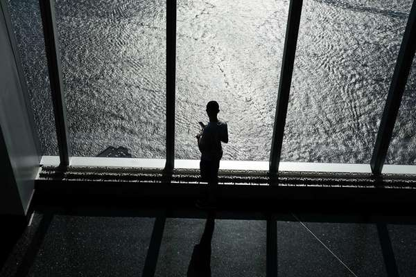 A person looks out at the Hudson River