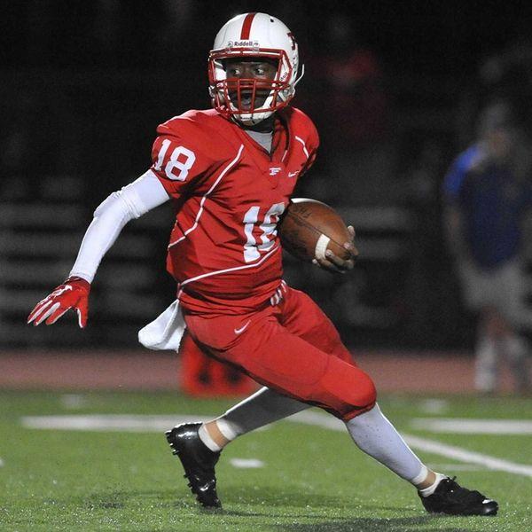 Freeport quarterback Rashad Tucker scrambles for yards during