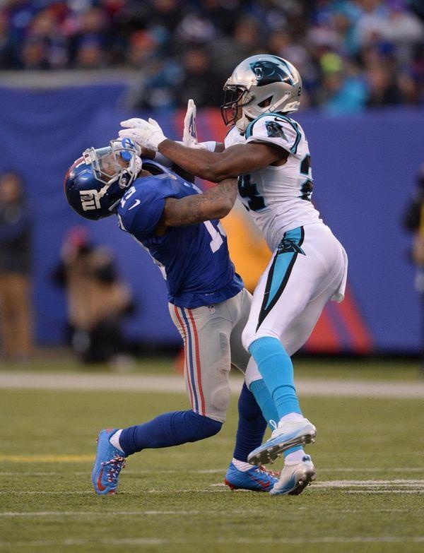 Carolina Panthers cornerback Josh Norman, right, gets into