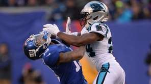 Carolina Panthers cornerback Josh Norman, right, gets into