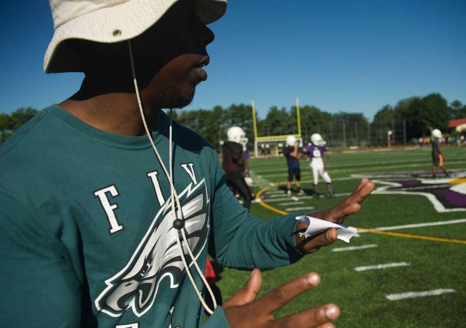Coach Derrick McNae gives instructions during practice at