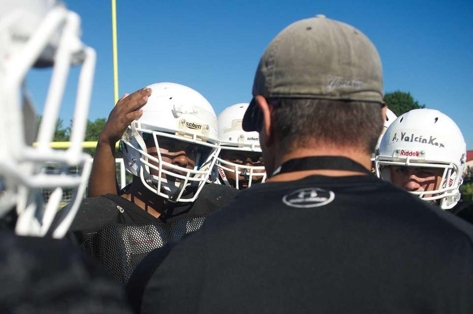 Head coach George Kasimatis gives instructions during practice