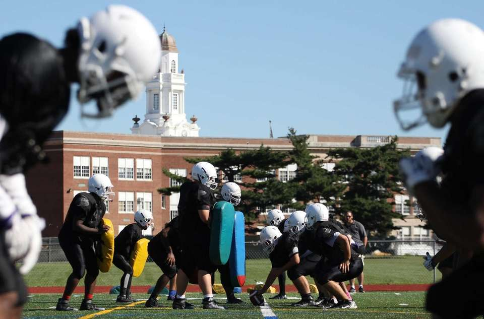 Players get ready for drills during practice at